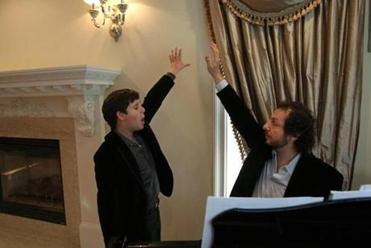 Clark Rubinshtein did vocal exercises with his voice teacher, Alexander Prokhorov, at home in Newton.